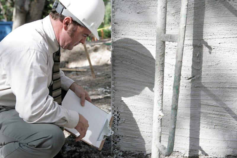 Building Inspector Checks Foundation